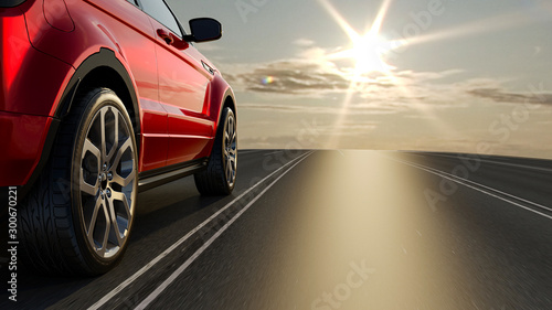 Fototapeta 3d car sedan rides on the road to meet the sun, 3D rendering. Wheel close-up. obraz