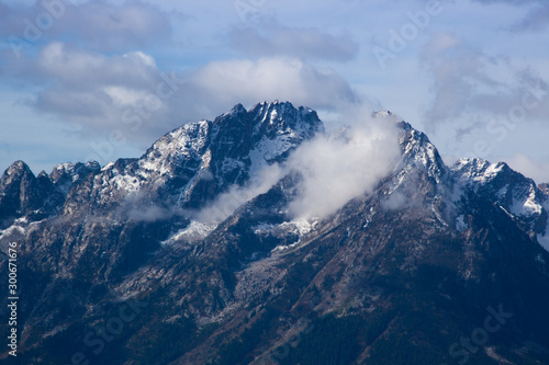 snow capped mountain with cloud cape