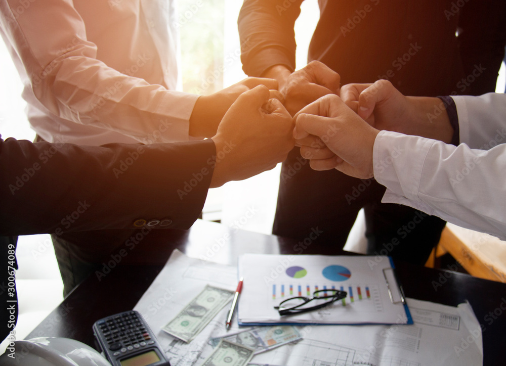 Fototapeta Teamwork Join Hands Support Together Collaboration Concept.Young Asian business people show symbolic hand for promised purpose to achieve the goal.