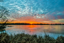 Sunset On Frozen Lake With Clouds