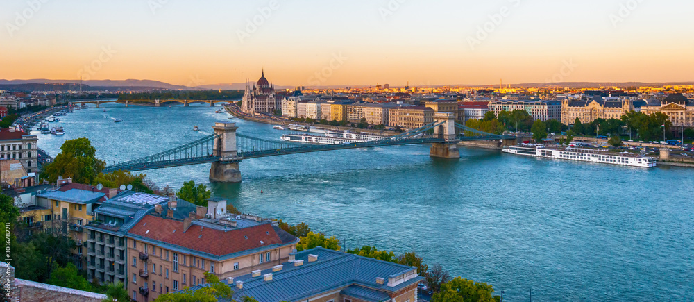 Budapest, Hungary - October 01, 2019: View of the Szechenyi Chain Bridge over Danube and the Hungarian Parliament Building in Budapest, Hungary
