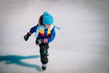 Young Boy Skating On Ice In Winter, Kids Seasonal Sport