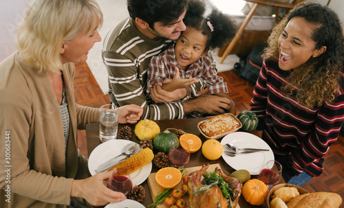 Fotobehang Kruidenierswinkel Happy Family Celebrating Thanksgiving Dinner at home . Celebration tradition concept