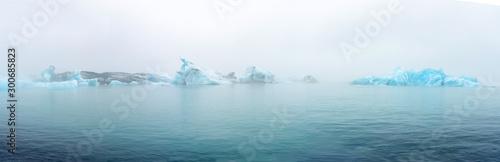 Fototapeta Fragments of iceberg in sea water. Iceland north sea