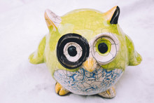 Porcelain Owl On Table With White Background. Glassware, Animal, Creative, Handmade Concept.