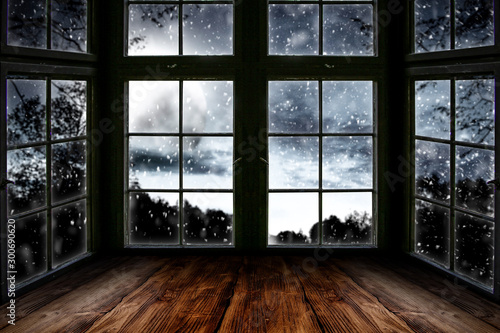 Fotomural Table top board with big window background and beautiful snowy winter landscape outside
