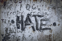 Hate Written/painted On Concrete Wall. Texture, Message, Quote, Statement Concept.