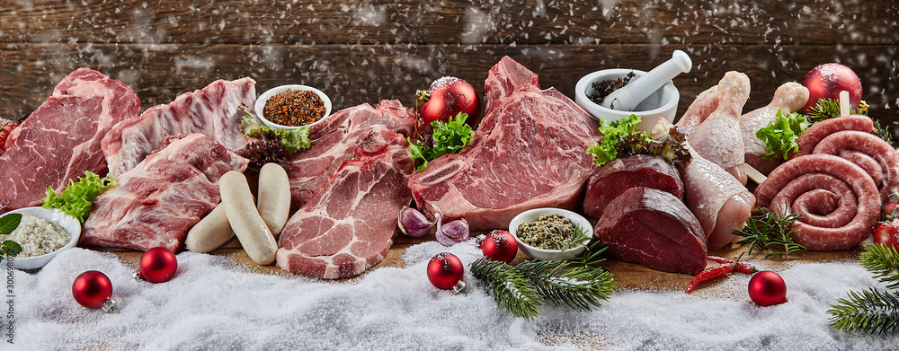 Fototapeta Christmas banner with assorted raw meat for a BBQ