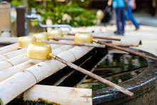 Traditional Japanese Ladle For Purification In A Cleansing Well In A Peaceful Japanese Temple.