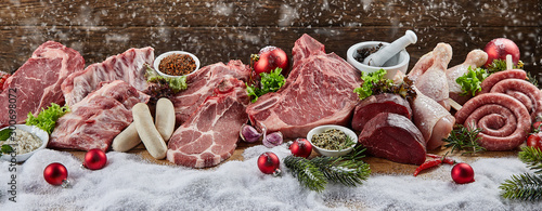 Christmas banner with assorted raw meat for a BBQ - 300698072
