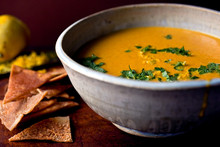 Lemon, Carrot And Tahini Soup Served In Bowl With Pita Crisps