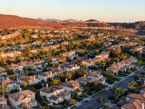 Recess Fitting Deep brown Aerial view of residential modern subdivision luxury house neighborhood during sunset. South California, USA
