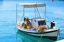 View Of A Small Wooden Fishing Boat With Fishing Tackle.
