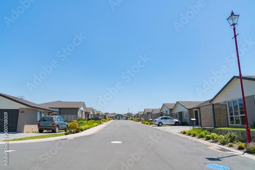 Foto auf Leinwand Dunkelgrau New subdivision street with uniform homes.