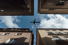Passenger Plane Flying Over The Roofs Of Residential Homes, Low Airplane Flies, Transportation