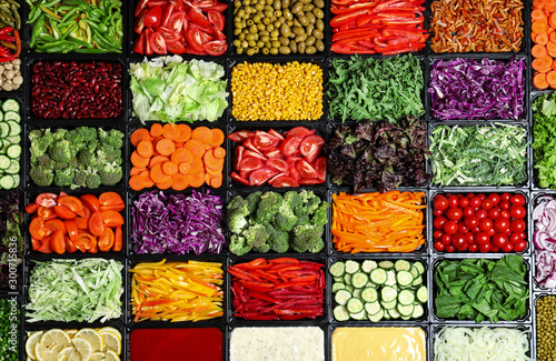 Salad bar with different fresh ingredients as background, top view Wallpaper Mural