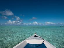 Sailing A Boat Around Blue Lagoon And Luxury Overwater Villas At Bora Bora Island, Tahiti, French Polynesia