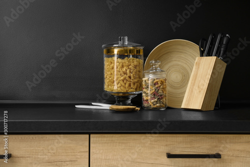 Fotomural  Products and modern kitchen utensils on black table