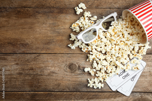 Leinwand Poster  Popcorn, cinema tickets and 3d glasses  on wooden background, flat lay