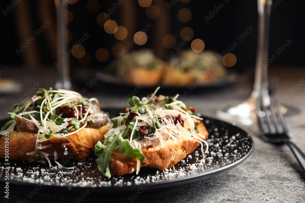 Fototapeta Delicious bruschettas with beef and cheese on grey table, closeup
