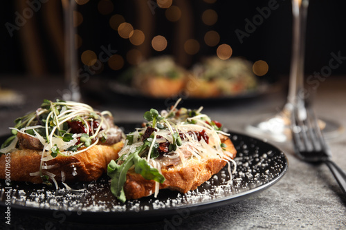 Obraz Delicious bruschettas with beef and cheese on grey table, closeup - fototapety do salonu