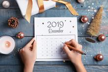 Woman Marking Date In Calendar...