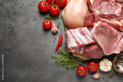 Fototapeta Flat lay composition with fresh meat on grey table. Space for text obraz