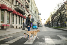 Young Woman With Dog On Leash ...