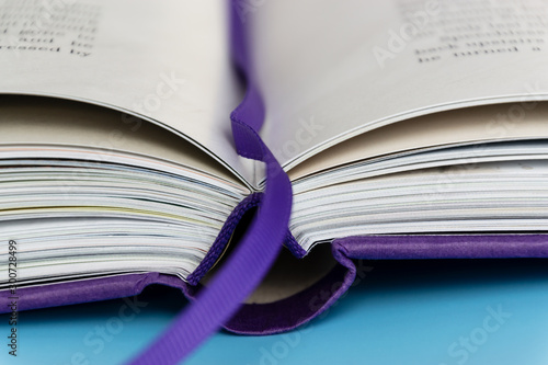 Vászonkép A hardback book with bookmark lying closed close up, selective focus