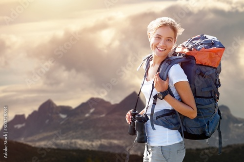 Woman with backpack trekking through the wilderness