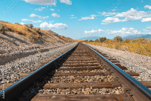Spoed Foto op Canvas Spoorlijn Straight railroad track in Utah, USA - the way forward