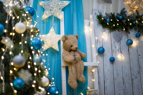 Fotografie, Obraz  Christmas and New Year living room interior with decorated firtree, brown teddy