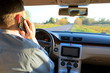 Hand using phone sending a text while driving to work ,businessman