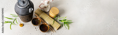 Pinturas sobre lienzo  Still life with tea set, furoshiki wrapping present gift, scattered tea, bamboo mat, chopsticks, incense