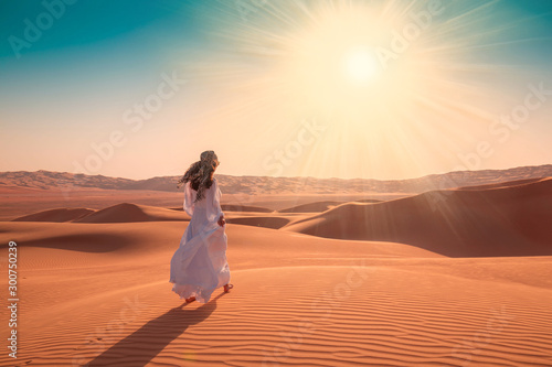 UAE. Woman in desert Fototapeta