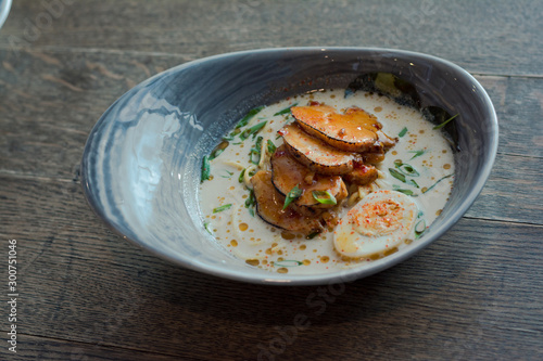 Valokuvatapetti Tom Kha Gai - Thai coconut milk soup with pieces of chicken in a beautiful plate