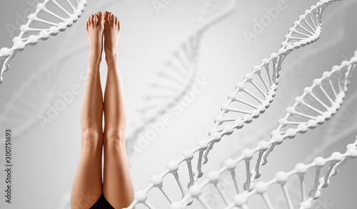 Fotografía  Perfect female legs among DNA stems over gray background.
