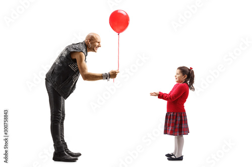 Male rock star giving a red balloon to a little girl Canvas Print