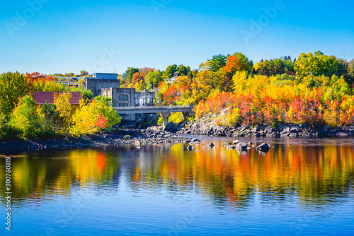 Foto auf Leinwand Pool Autumn Landscape View of Color Trees with Dam on Lake in City Park
