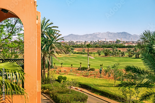 Cadres-photo bureau Maroc View of Marrakech from a golf resort with green fields and palms in Morocco