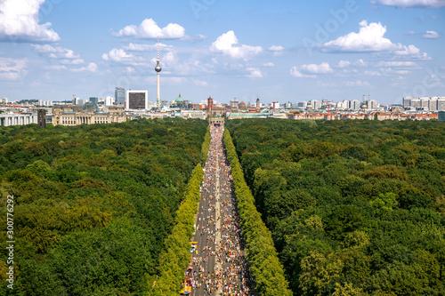Spoed Fotobehang Berlijn Aerial view of Berlin with Strasse des 17 Juni and Brandenburger Tor during the Christopher Street Day