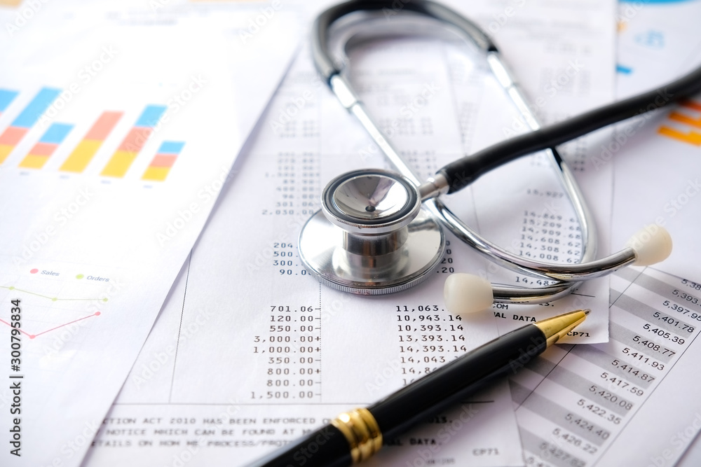 Fototapeta Stethoscope with Pen, Charts and Graphs, Finance, Account, Statistics, Investment, Analytic Research Data Economy Spreadsheet and Business Company Concept
