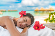 Luxury Hotel Spa Massage Table Asian Woman Relaxing On Exotic Travel Vacation On Beach. Summer Pampering Lifestyle Skincare Body Care.