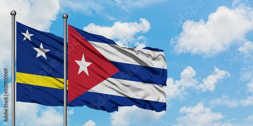Curacao and Cuba flag waving in the wind against white cloudy blue sky together Canvas Print
