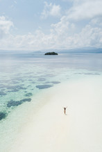 Woman Walking Alone On Amazing Tropical White Sand Beach. Aerial Drone View From Above. Tropical Background And Travel Concept.
