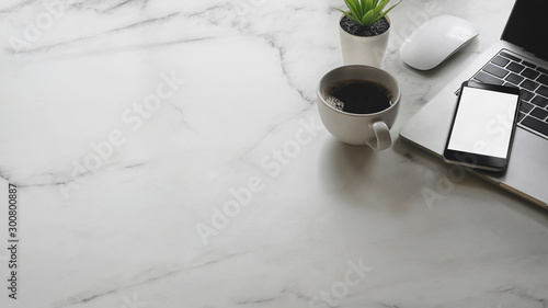 Fototapeta Mockup smartphone on Office desk with marble table. obraz