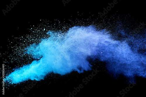 Blue sky color powder explosion on black background. - 300806485