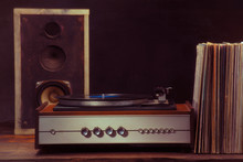 Vintage Turntable Audio Column And Vinyl Records On A Black Background. Retro Style