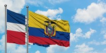 Dominican Republic And Ecuador Flag Waving In The Wind Against White Cloudy Blue Sky Together. Diplomacy Concept, International Relations.