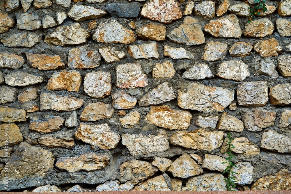 Abstract textured background of stone surface of part of wall